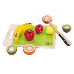 Delbara frukter och grönsaker med skärbräda, lekmat